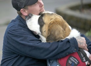 Desert Storm veteran Shawn Brooks, of Molalla, Ore., hugs his dog Bella before they test for a service-dog certification at Man's Best Friend kennel in Battle Ground. Brooks suffers from post-traumatic stress disorder. (Photo by Zachary Kaufman)