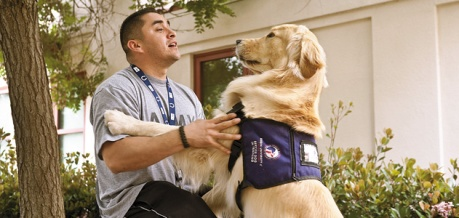 Robert Soliz is a former Army Specialist participating in Paws for Purple Hearts. Another group that pairs veterans with PTSD  (Photo Credit: Joseph Matthews, Veterans Affairs)