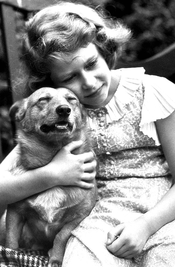 princess-elizabeth-hugging-a-corgi-dog-in-july-1936