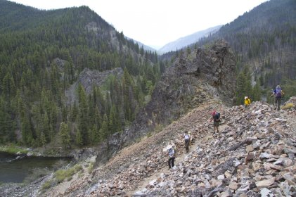 Hikers trekking through a talus field on the Fern Lake Trail in the Rocky Mountain National Park, Colorado